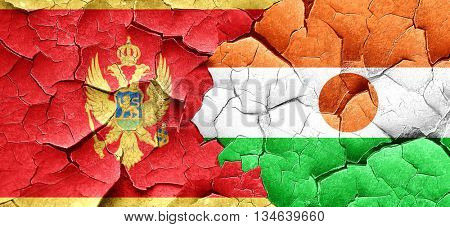 Montenegro flag with Niger flag on a grunge cracked wall