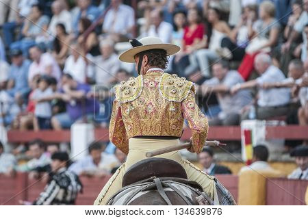 Jaen Spain - September 10 2011: Picador bullfighter lancer whose job it is to weaken bull's neck muscles in the bullring for Jaen Spain