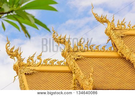 The gold roof of unique architecture in the Wat Rong Khun temple at Chiang Rai, Thailand.