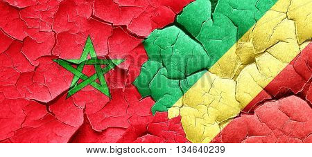 Morocco flag with congo flag on a grunge cracked wall
