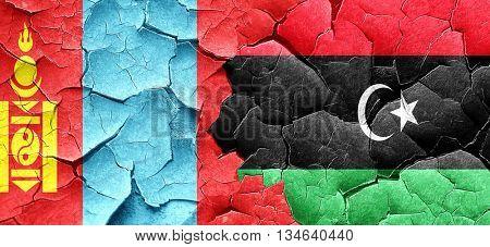Mongolia flag with Libya flag on a grunge cracked wall