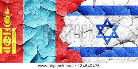 Mongolia flag with Israel flag on a grunge cracked wall