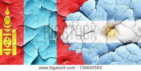 Mongolia flag with Argentine flag on a grunge cracked wall
