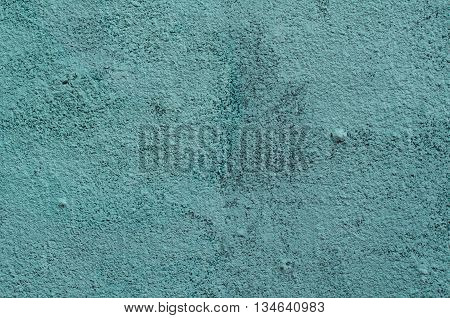 Background of a blue and green stucco coated and painted exterior rough cast of cement and concrete wall texture decorative coating