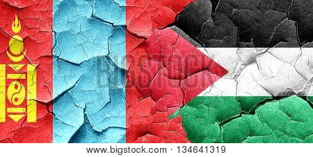 Mongolia flag with Palestine flag on a grunge cracked wall