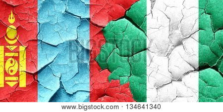 Mongolia flag with Nigeria flag on a grunge cracked wall