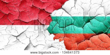 monaco flag with Bulgaria flag on a grunge cracked wall