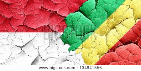 monaco flag with congo flag on a grunge cracked wall