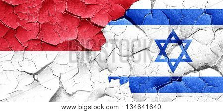 monaco flag with Israel flag on a grunge cracked wall