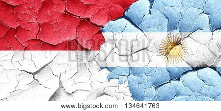 monaco flag with Argentine flag on a grunge cracked wall