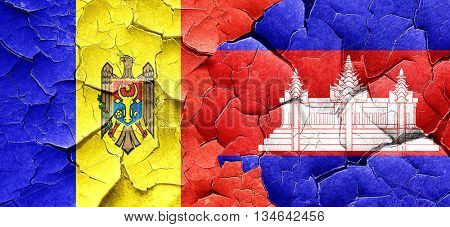 Moldova flag with Cambodia flag on a grunge cracked wall