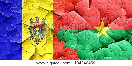 Moldova flag with Burkina Faso flag on a grunge cracked wall