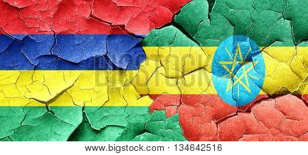 Mauritius flag with Ethiopia flag on a grunge cracked wall