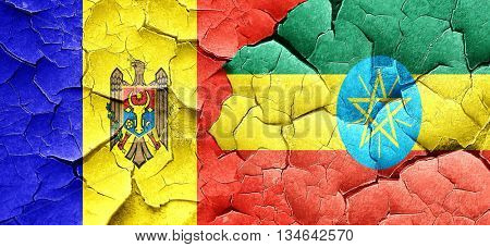 Moldova flag with Ethiopia flag on a grunge cracked wall