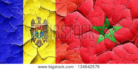 Moldova flag with Morocco flag on a grunge cracked wall