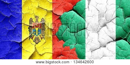 Moldova flag with Nigeria flag on a grunge cracked wall