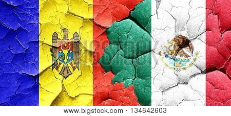Moldova flag with Mexico flag on a grunge cracked wall