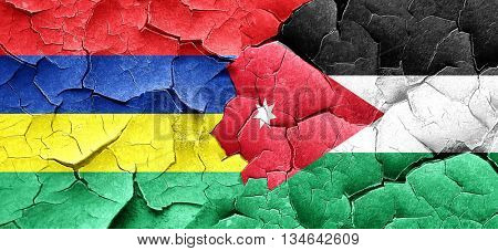 Mauritius flag with Jordan flag on a grunge cracked wall