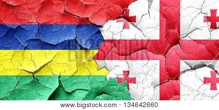 Mauritius flag with Georgia flag on a grunge cracked wall