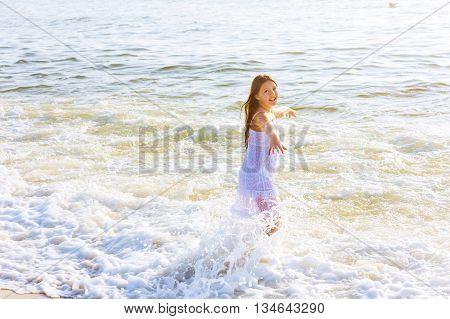 Beautiful Teenage Girl On The Ocean