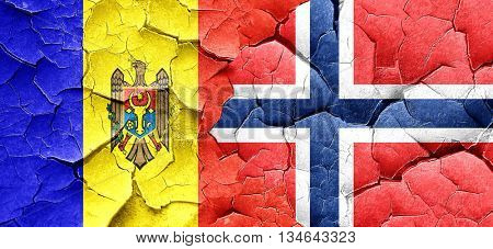 Moldova flag with Norway flag on a grunge cracked wall