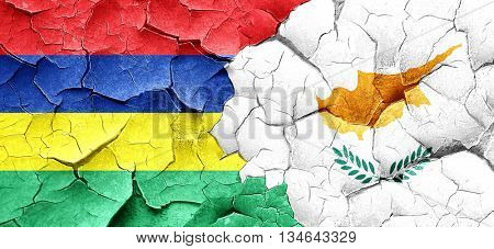 Mauritius flag with Cyprus flag on a grunge cracked wall