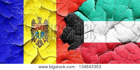 Moldova flag with Kuwait flag on a grunge cracked wall