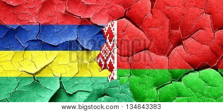 Mauritius flag with Belarus flag on a grunge cracked wall