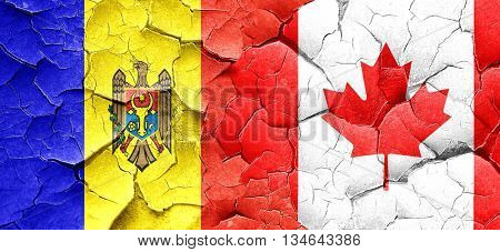 Moldova flag with Canada flag on a grunge cracked wall