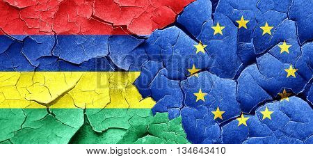 Mauritius flag with european union flag on a grunge cracked wall