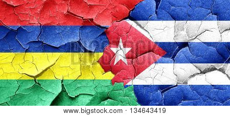 Mauritius flag with cuba flag on a grunge cracked wall