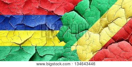 Mauritius flag with congo flag on a grunge cracked wall