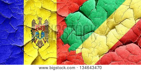 Moldova flag with congo flag on a grunge cracked wall