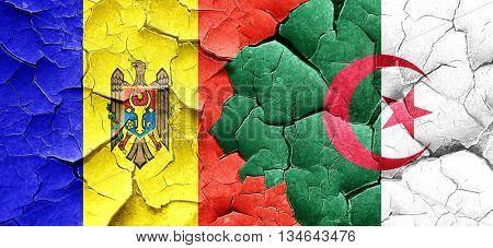 Moldova flag with Algeria flag on a grunge cracked wall