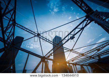 steel bridge and modern skyscraper,tianjin china