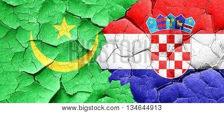 Mauritania flag with Croatia flag on a grunge cracked wall