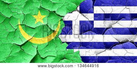 Mauritania flag with Greece flag on a grunge cracked wall