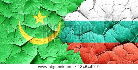 Mauritania flag with Bulgaria flag on a grunge cracked wall