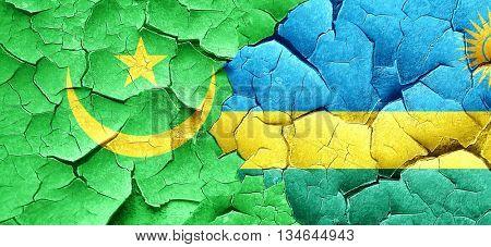 Mauritania flag with rwanda flag on a grunge cracked wall