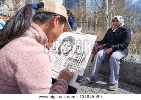 NEW YORK - CIRCA MARCH, 2016: woman posing for painter in New York. The City of New York is the most populous city in the United States