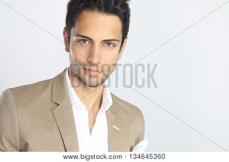 Portrait of an handsome young buisnessman over a white background
