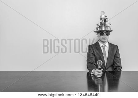 Vintage businessman sitting at office desk with lamp