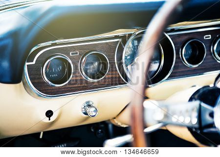 Benalmadena, Spain - June 21, 2015: Inside view of classic Ford Mustang, with focus in dashboard, in Benalmadena (Spain), on June 21, 2015.