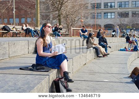 NEW YORK - CIRCA MARCH, 2016: outdoor portrait of young woman in New York. The City of New York is the most populous city in the United States
