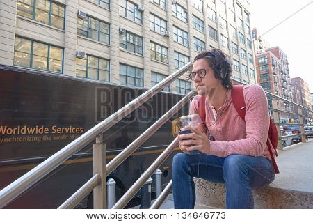 NEW YORK - CIRCA MARCH, 2016: outdoor portrait of young man in New York. The City of New York is the most populous city in the United States