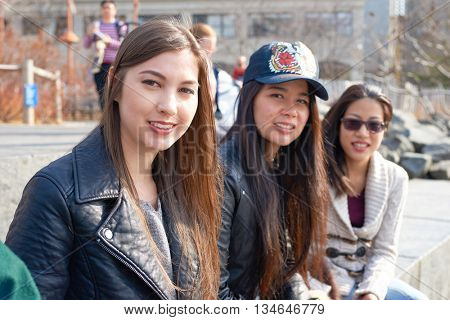 NEW YORK - CIRCA MARCH, 2016: outdoor portrait of young people in Brooklyn, New York. The City of New York is the most populous city in the United States