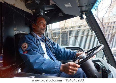 NEW YORK - CIRCA MARCH, 2016: portrait of African American bus driver in New York. The City of New York is the most populous city in the United States