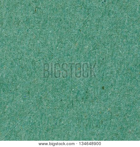 Seamless texture, dense cardboard with green fibers