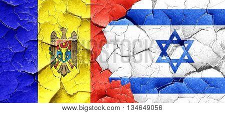 Moldova flag with Israel flag on a grunge cracked wall