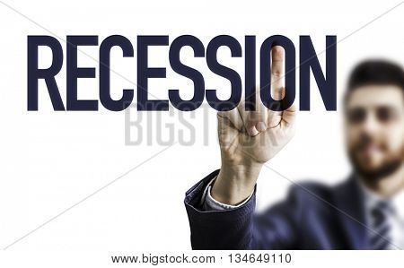 Business man pointing the word: Recession